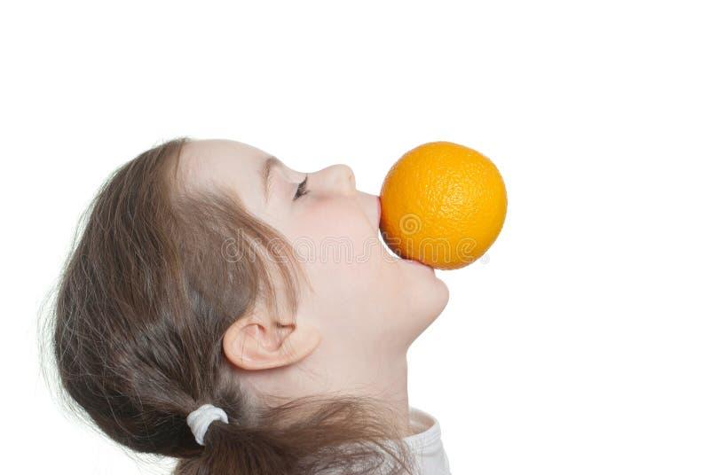 Girl with orange. Isolated photo in my studio stock photography