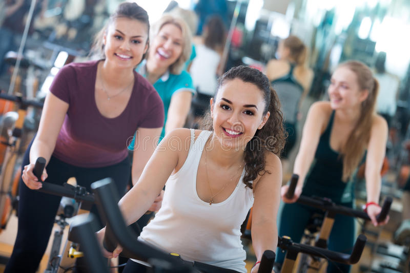 Girl and other females working out in sport club royalty free stock photography