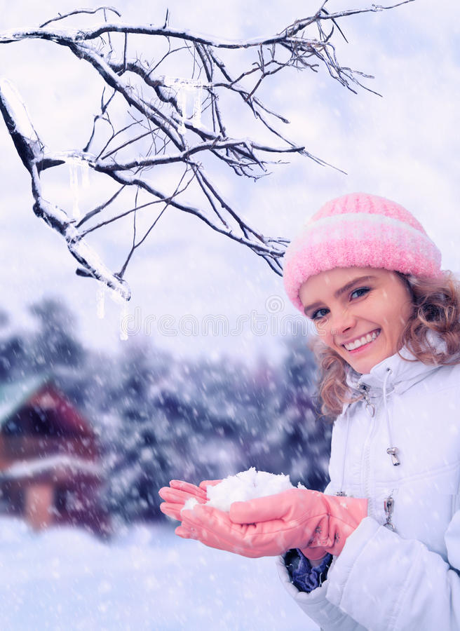 Download Girl Outdoor In Winter Holds Snow In Hands Stock Photo - Image: 12540246