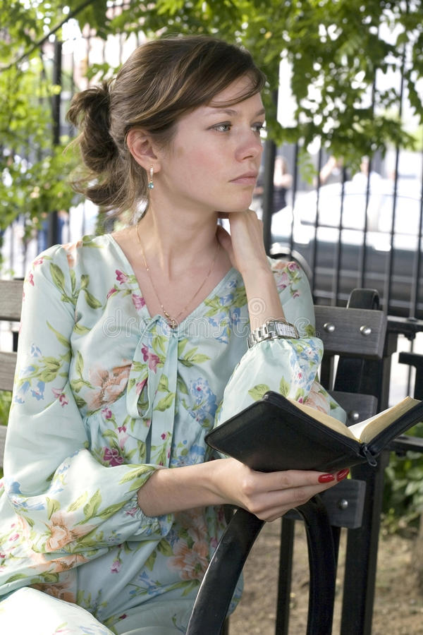 Download Girl outdoors with Bible stock photo. Image of woman - 10680448