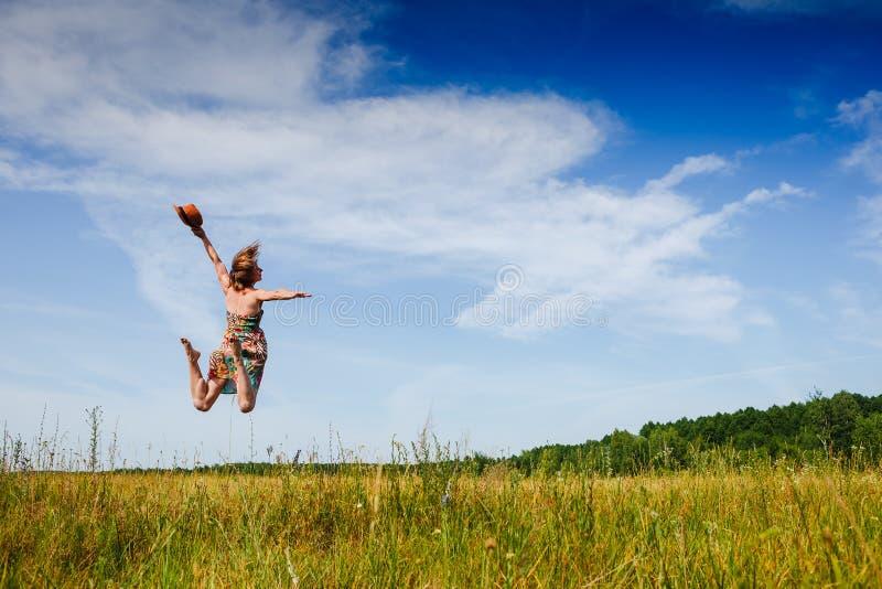 Girl Outdoors enjoying nature. Fun jump ). Summer time stock photography