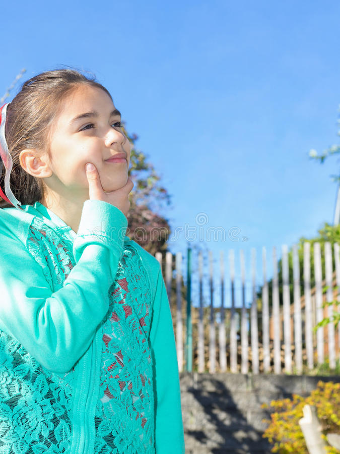 Girl Outdoors Thinking And Enjoying The Day royalty free stock photography