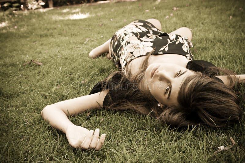 Girl over grass royalty free stock photos