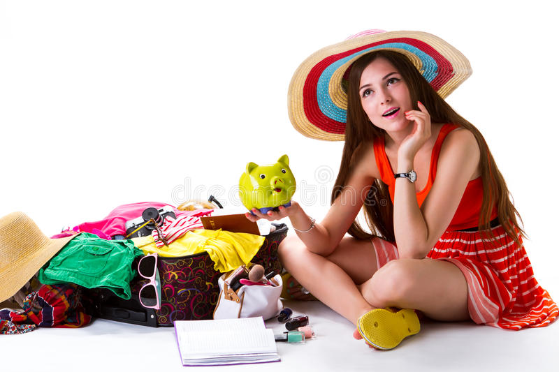 Girl beside overfilled suitcase. stock photo