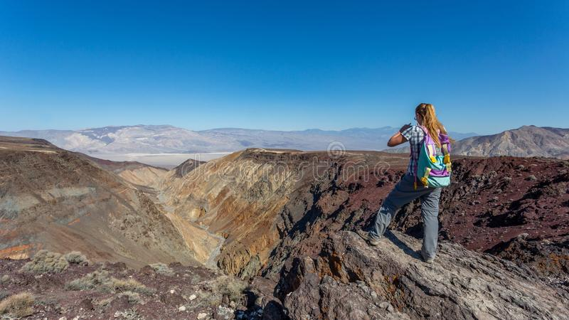 Girl overlooking Death Valley at Father Crowley Overlook, Nevada, United States. Girl overlooking Death Valley at Father Crowley Overlook in a sunny day, Nevada royalty free stock photo