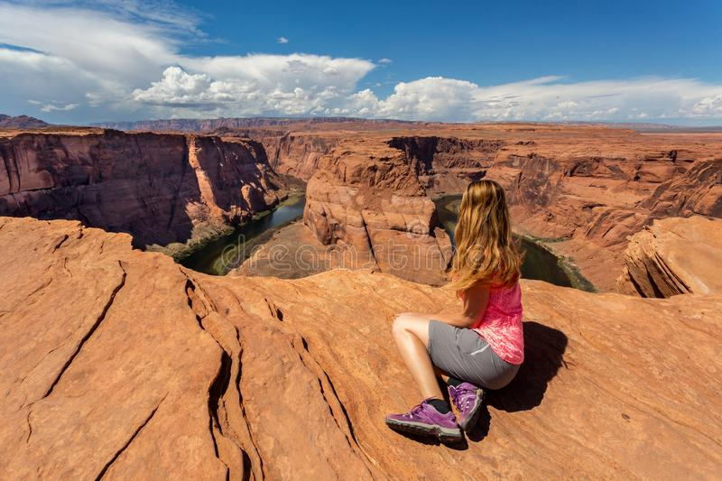 Girl overlooking Horse Shoe Bend landscape, Arizona, United States. Girl overlooking Horse Shoe Bend landscape in a sunny day, Arizona, United States stock photography