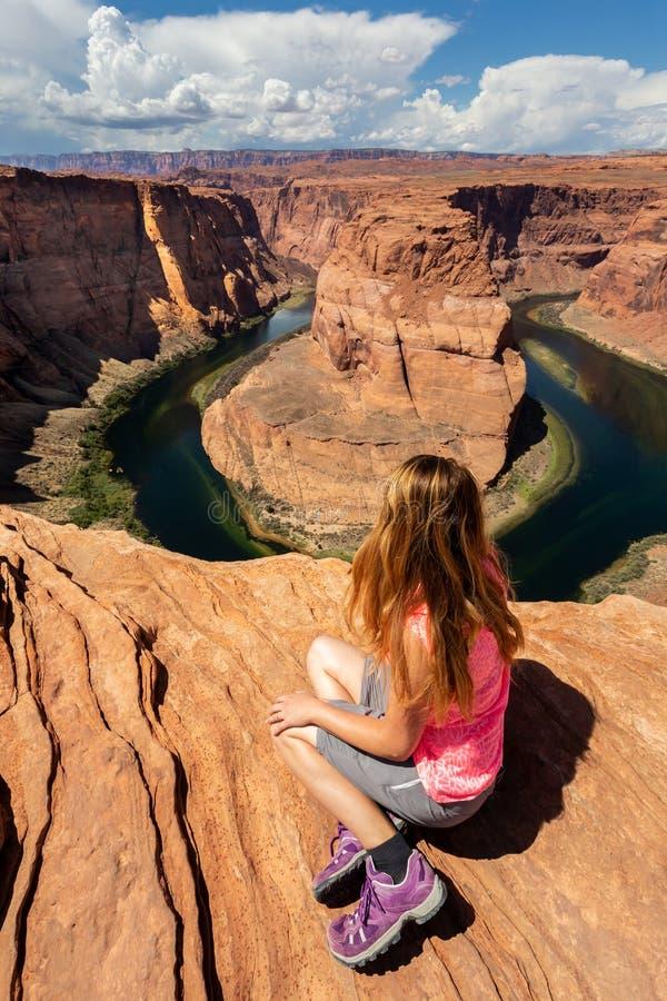 Girl overlooking Horse Shoe Bend landscape, Arizona, United States. Girl overlooking Horse Shoe Bend landscape in a sunny day, Arizona, United States stock photo
