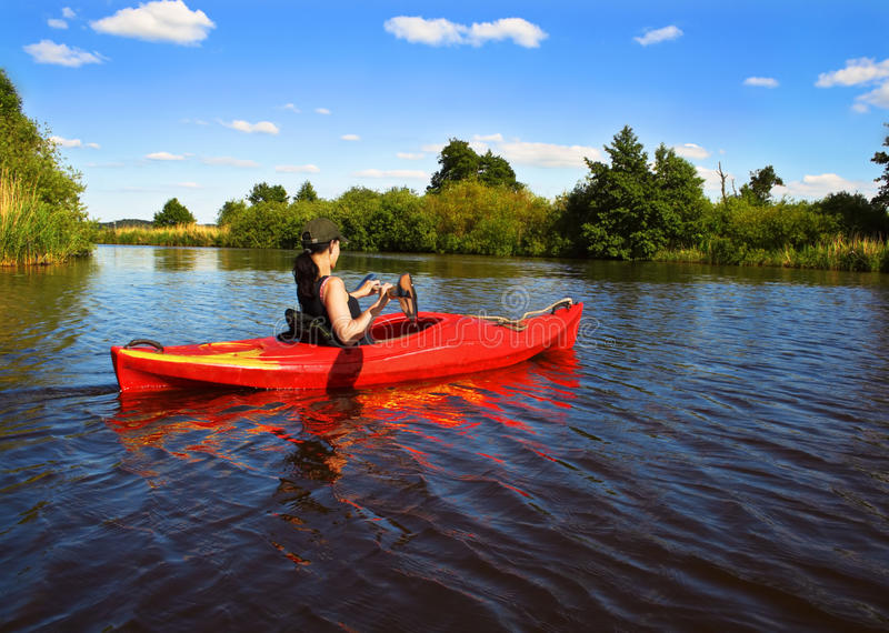 Girl with paddle and kayak 2 royalty free stock photography