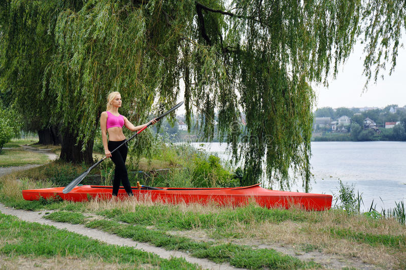 Girl with paddle stock images