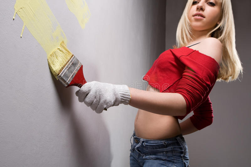 Girl with paint brush stock image