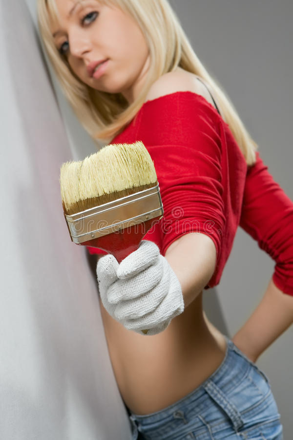 Girl with paint brush royalty free stock images