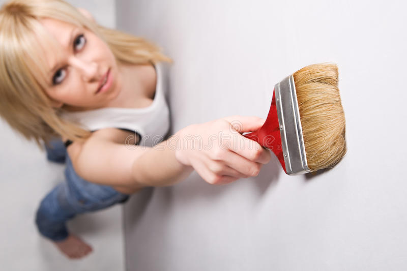 Girl with paint brush royalty free stock photo