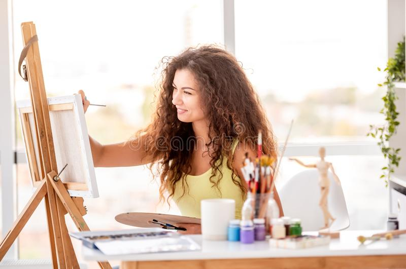 Girl painter making new picture royalty free stock photography