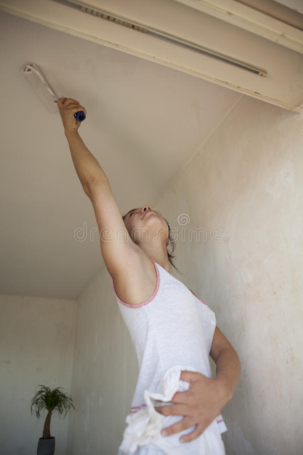 Girl painting apartment stock images