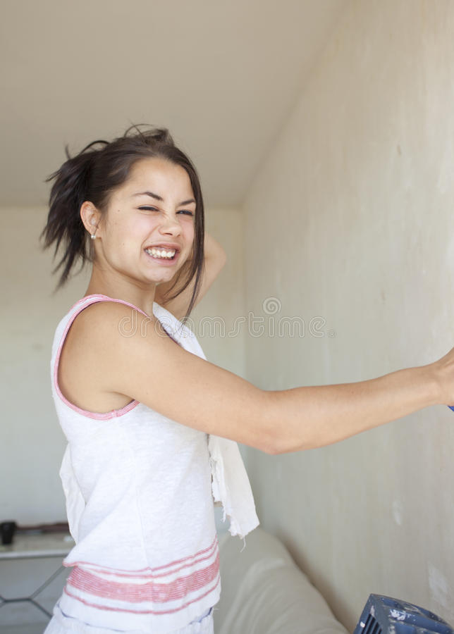 Girl painting apartment stock photography