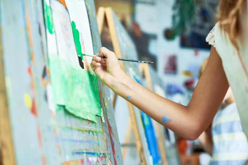 Girl Painting in Art Class stock images