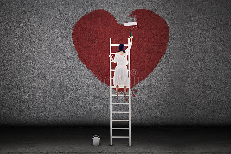 Girl painting love on the wall vector illustration