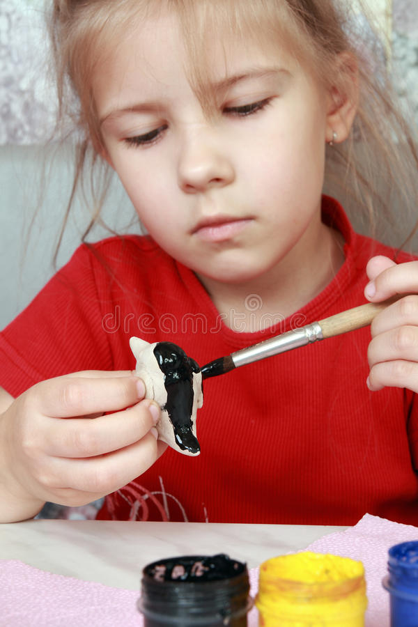 Girl paints crafts stock photography
