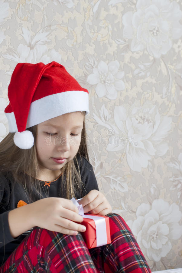 Girl in pajamas with presents boxes on Christmas morning stock photos