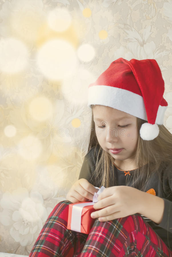 Girl in pajamas with presents boxes on Christmas morning stock photography
