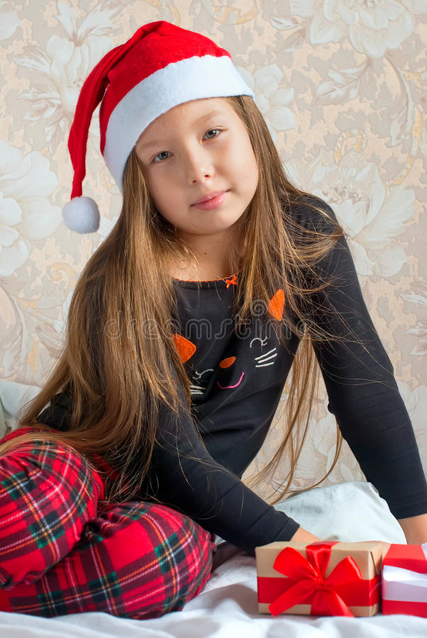 Girl in pajamas with presents boxes on Christmas morning royalty free stock images