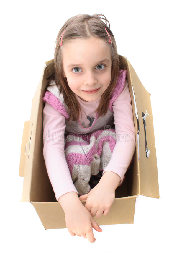 Girl in the paper box. Girl in the box isolated on the white background royalty free stock photography