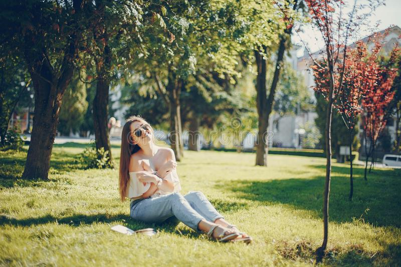 Girl in a park royalty free stock photography