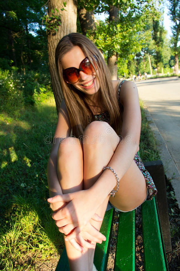 Download Girl on park bench stock photo. Image of glasses, sunny - 24352958