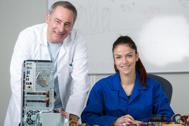 Girl passed exam for fixing computer royalty free stock image