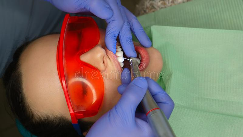 Girl patient in dental clinic stock photos