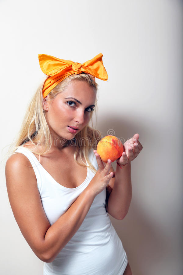 Download Girl With Peach And Ribbon. Stock Photos - Image: 20612523