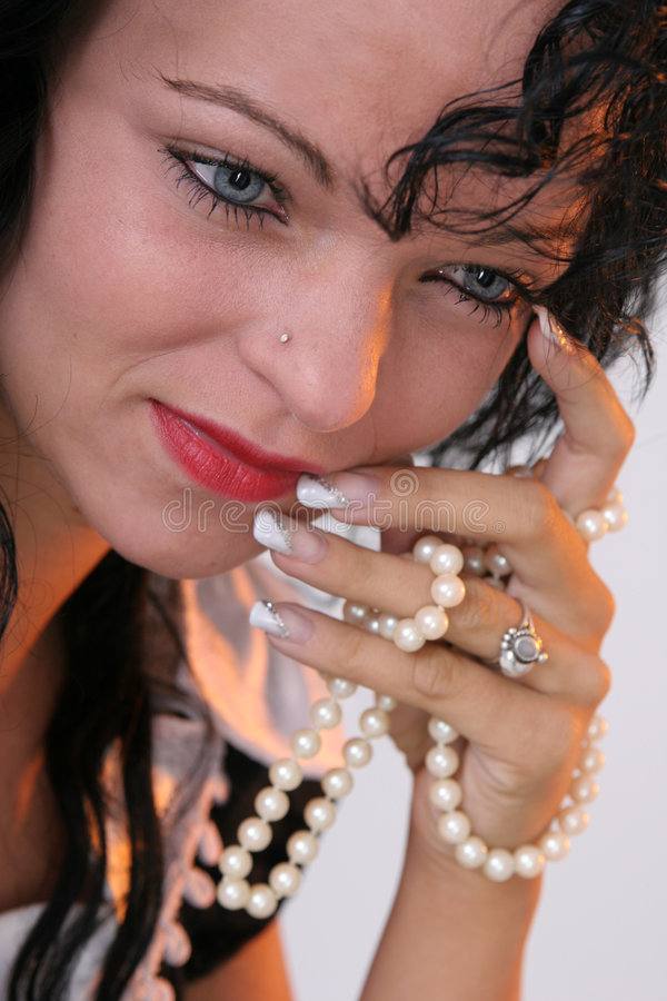 Girl with pearls in her hand stock image