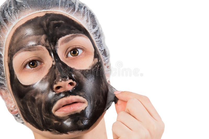 Girl with peel-off mask stock photos