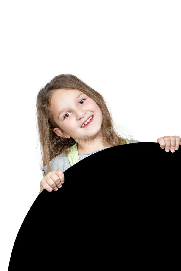 Girl peeping from behind a round panel royalty free stock photos