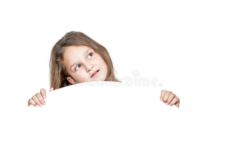 Girl peeping from behind a round white panel stock photo