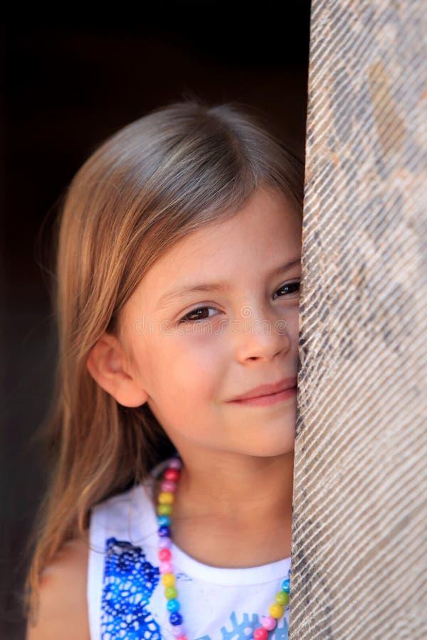 Free Girl Peeping From Behind Pillar Stock Images - 14566654
