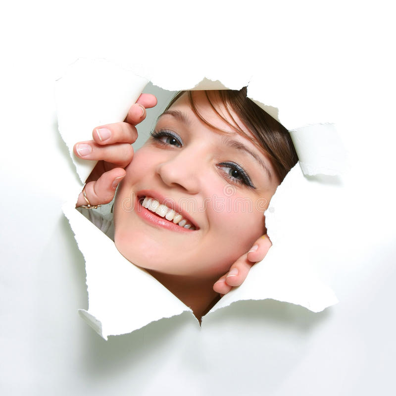 Download Girl Peeping Through Hole In Paper Stock Photo - Image: 12426322