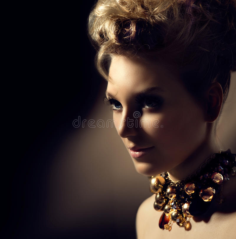 Girl with perfect makeup and hairstyle. Beautiful model girl with perfect fashion makeup and hair style royalty free stock images