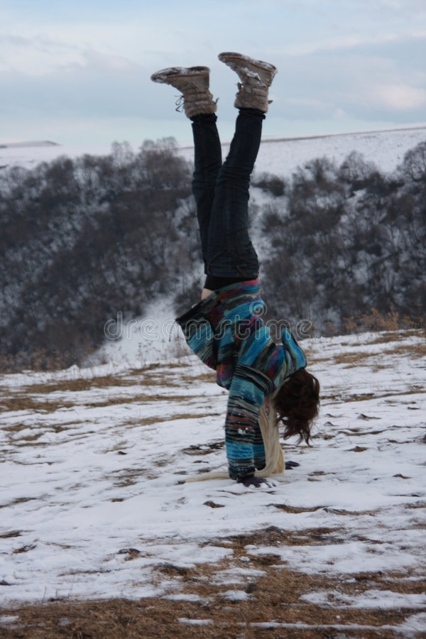 Girl performing handstand stock photography