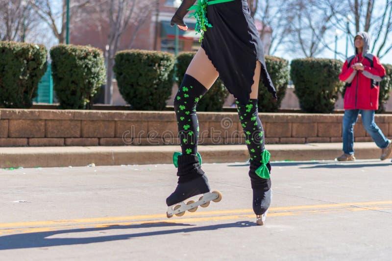 Girl performing Irish dance on roller skates stock image
