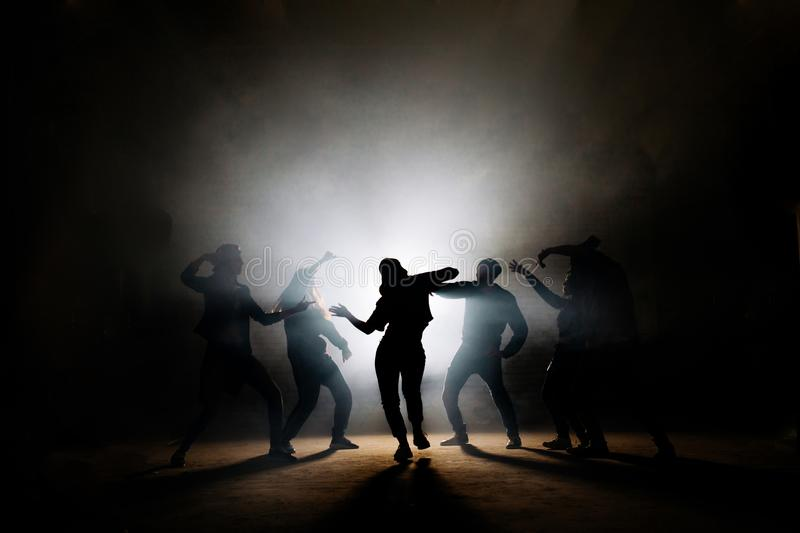 Girl performing solo in front of her friends on stage royalty free stock images