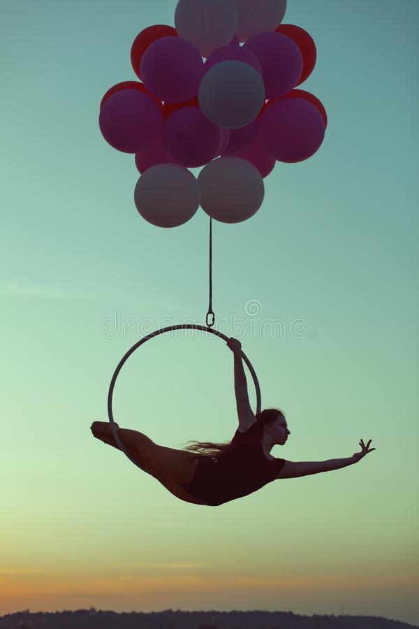 Girl performs acrobatic stunts. royalty free stock images