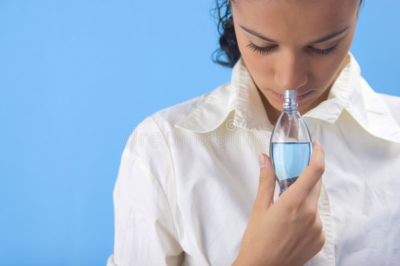 Girl with perfume royalty free stock images