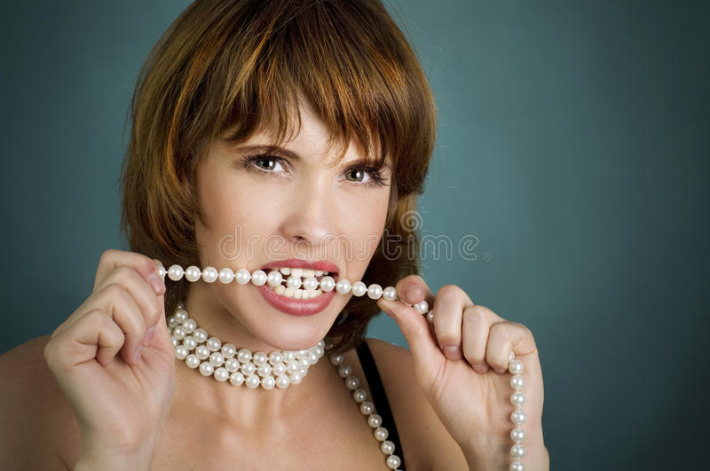 Girl with perls an red lips stock images