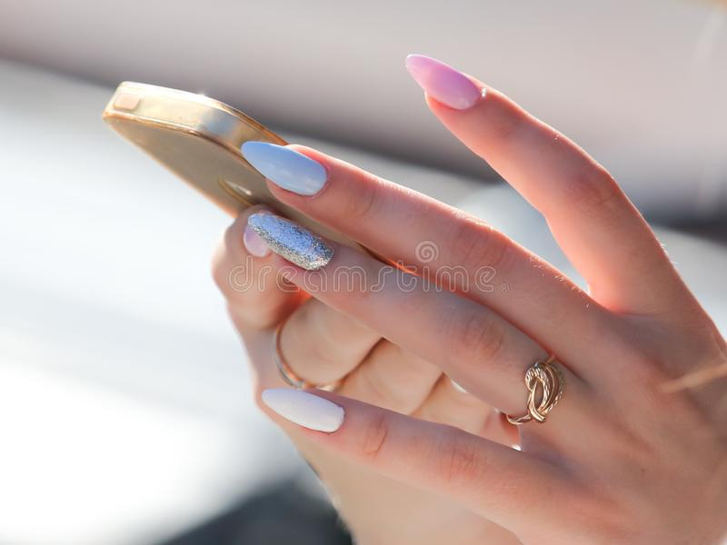 Girl with phone in hand royalty free stock photos
