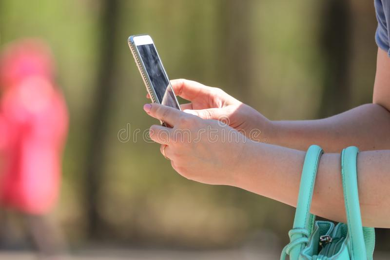 Girl with phone in hand royalty free stock images