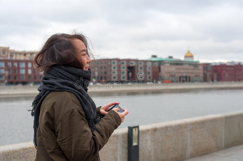 Girl with the phone smiling stock photo