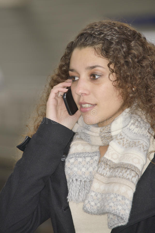 Girl phoning in train station royalty free stock image