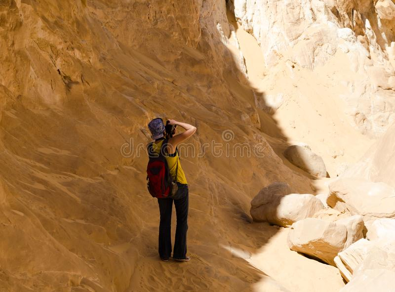 Girl photographer takes pictures of the mountains in the canyon in Egypt Dahab South Sinai stock images