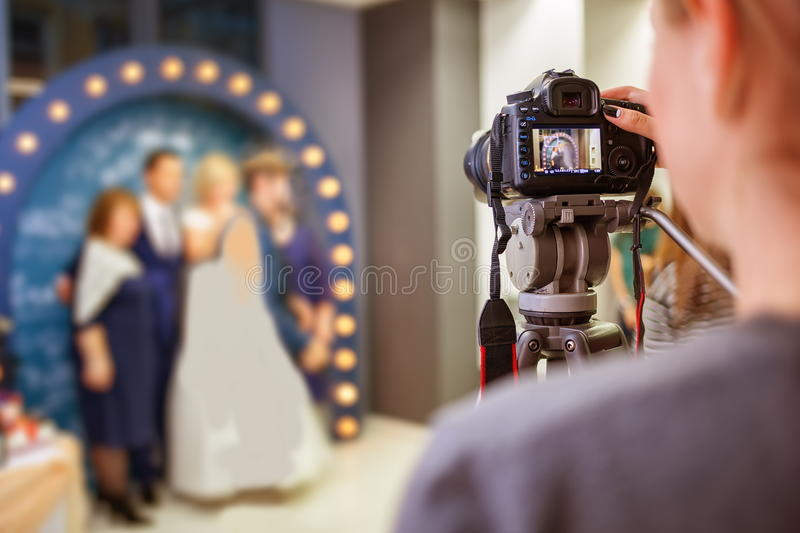 Girl the photographer at the wedding royalty free stock photo